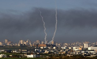 Trails of smoke are seen after launch of rockets from Gaza